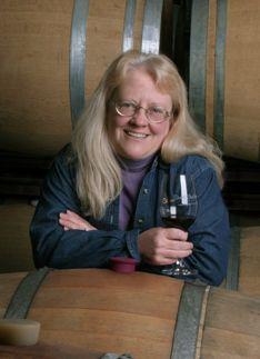 Carol shelton enjoying a barrel sample of Zinfandel