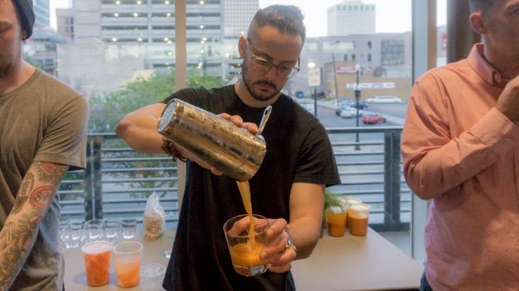 Farm To Glass 2015 awards party - Giancarlo Farina pouring cocktail
