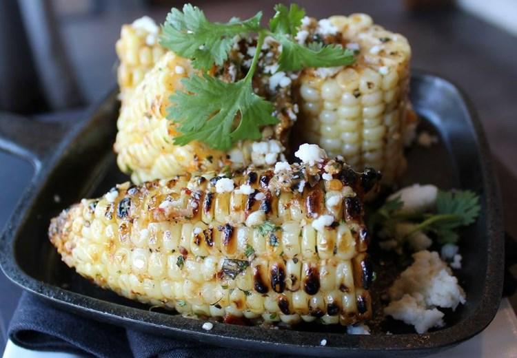 Avenues Proper - corn on the cob with Calabrian chili butter, cotija, and cilantro